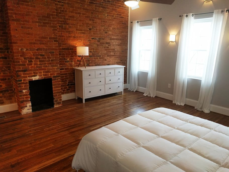 Brick fireplace, vaulted ceilings and lots of natural light in the master suite