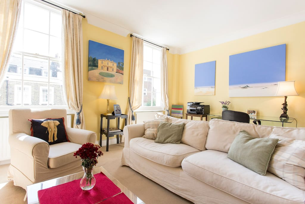 Beautifully furnished living room with a large sofa and flat screen TV