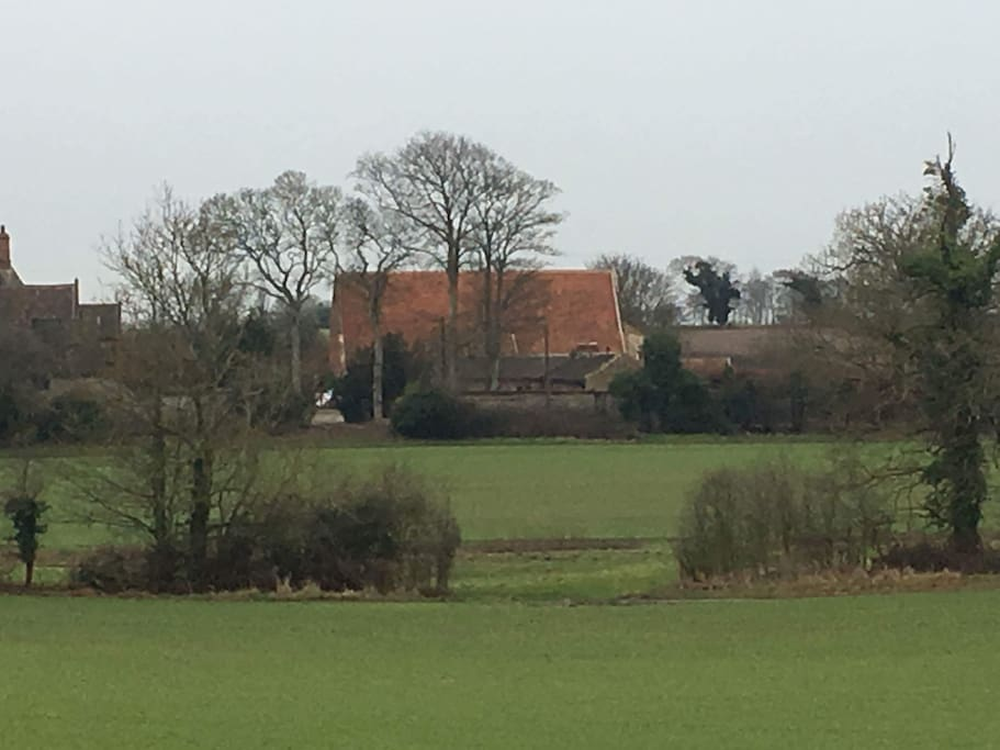 A view of Swafield Medieval Barn from across the nearby fields