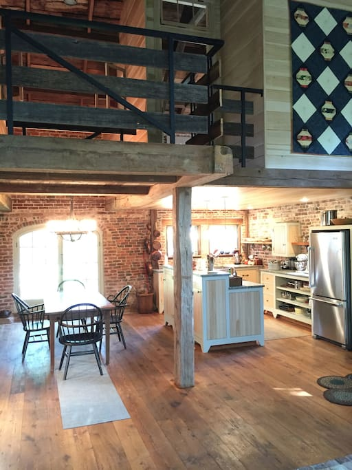Kitchen and dining under the 2nd floor loft. Large original domed glass double doors to North.