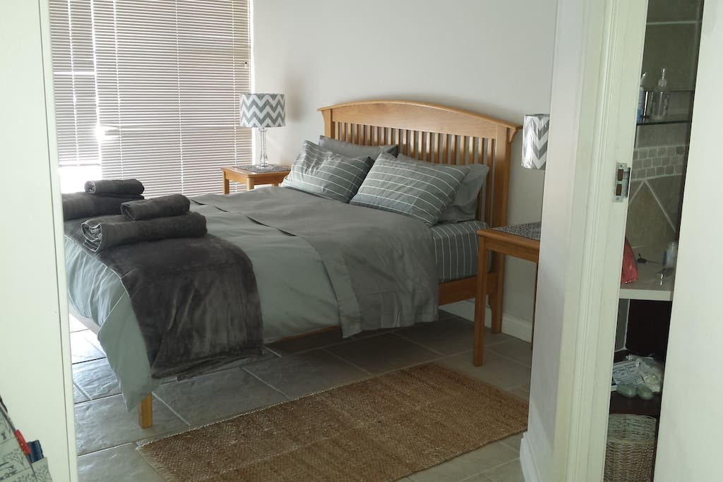 Main bedroom has beautiful sea views, Queen bed and en suite bathroom