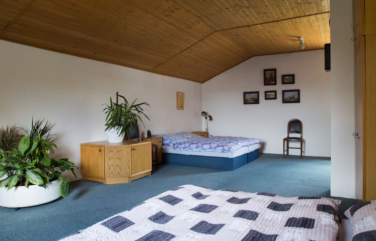 Large bedroom is even largen than it looks on the photo, but preferably do not play football in it.