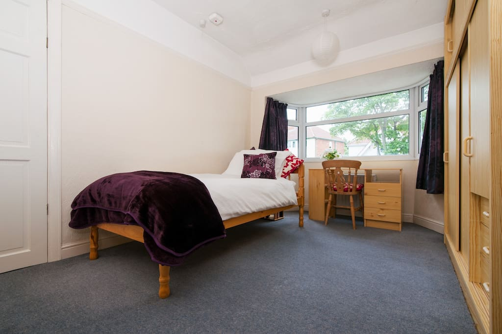 The room with a single bed