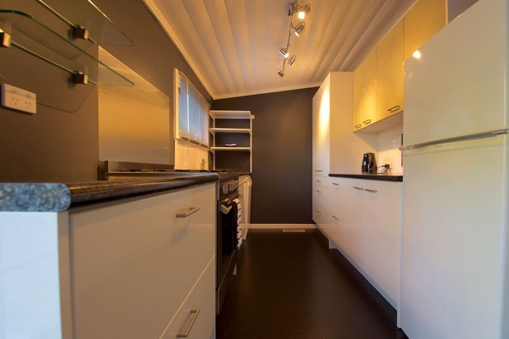 Modern cooks kitchen with large range stove and gas cooker top. Perfect for winter roasts.