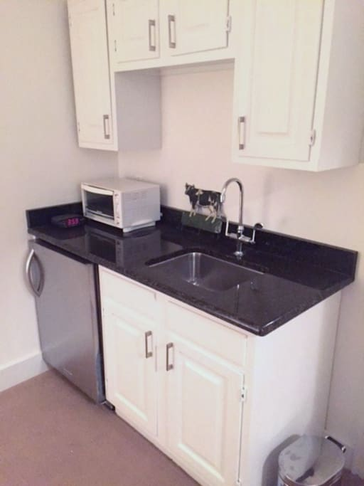 Kitchenette offers mini fridge, toaster oven, coffee maker, kettle, dishes, etc