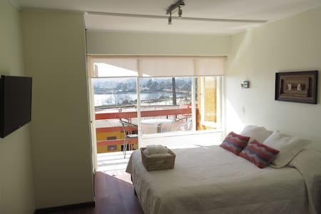 Neat and cozy apartment with a balcony overlooking the ocean and bird reserve on Aconcagua River. Includes a private bathroom, fully equipped kitchen, free Wifi, parking and daily cleaning service. The stuff speaks English.