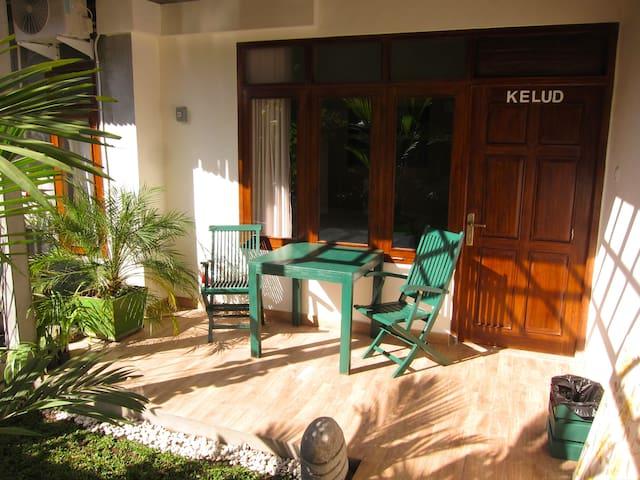 Room terrace next to central garden