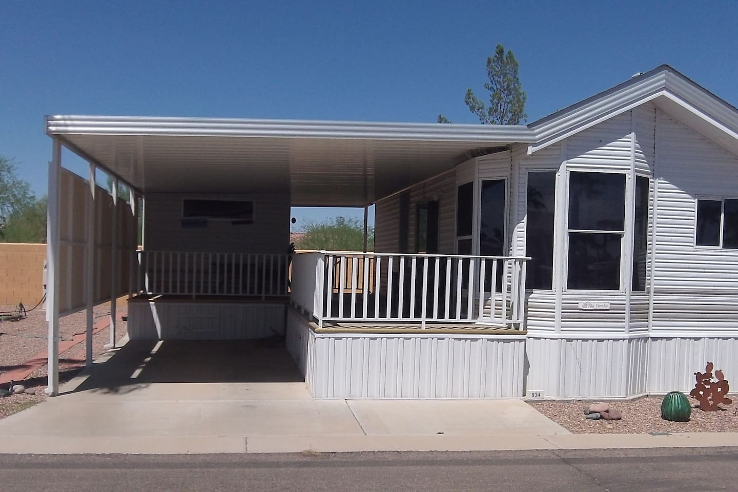 L-shaped deck, private patio at back.