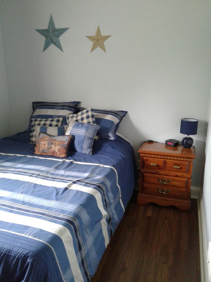 Furnished bedroom with queen bed