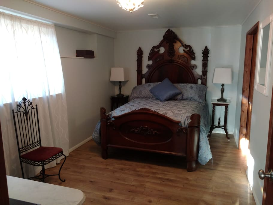 The Bedroom. The Victorian bed is from the 1800's. Sleep in luxury.  Bamboo sheets available if desired.