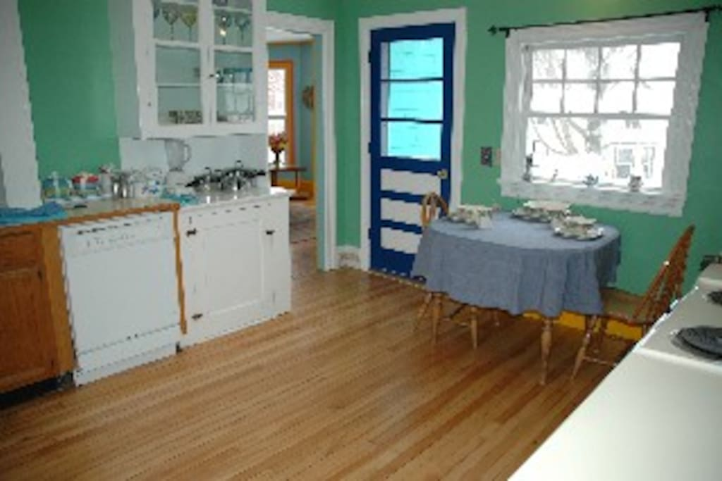 This is the large, eat-in kitchen.  The small balcony is right through the blue and white door and looks out towards the sunsets.