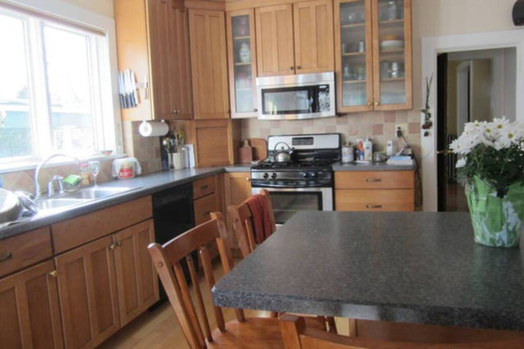 Kitchen has 5 bar stools, dishwasher, microwave, Kuerig