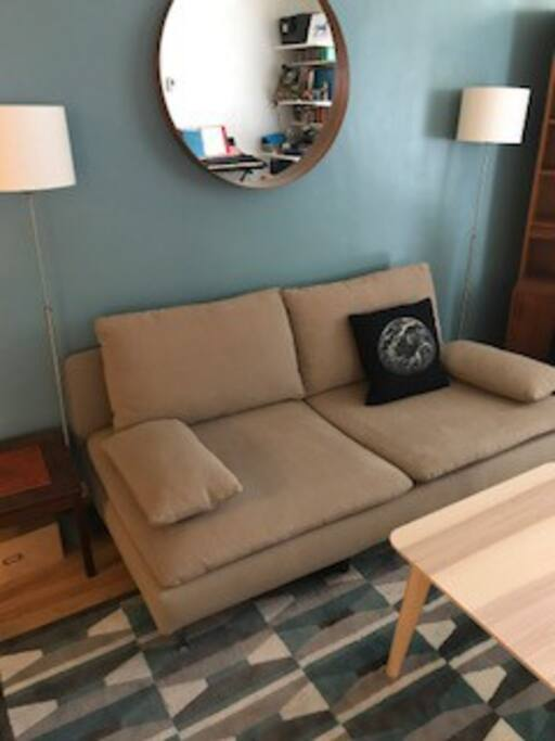 Cozy living room with fan. Lights are connected to the switch by the bookcase. Feel free to leave them on at night when you leave.
