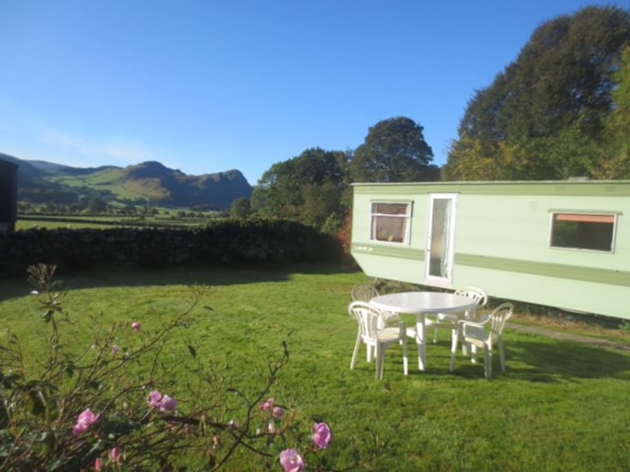 Sole caravan in private walled grass plot. Views!