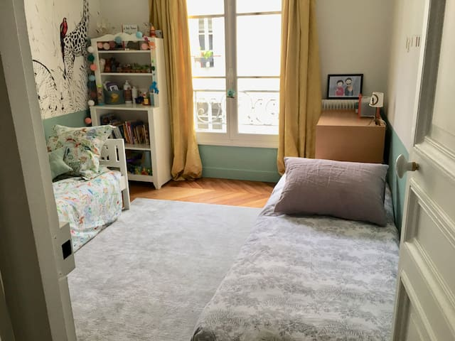 Kids bedroom with extra bed for teenager or adult if needed