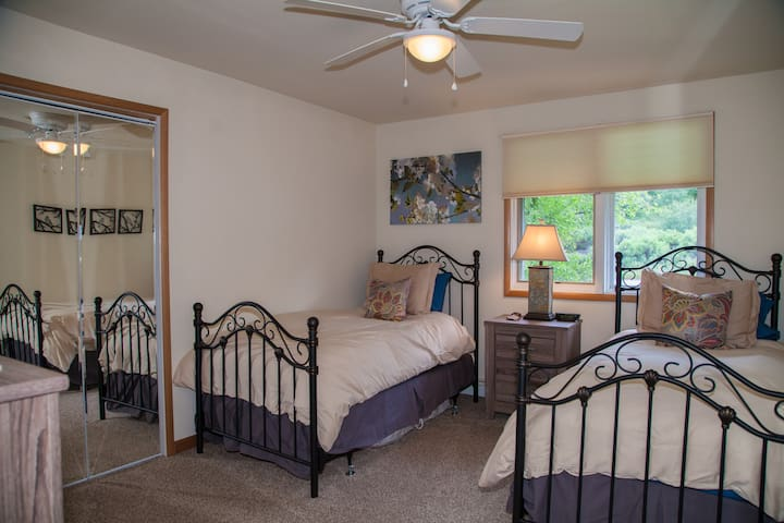 Second bedroom with twin beds. Can be comfortably converted to king  upon request.
