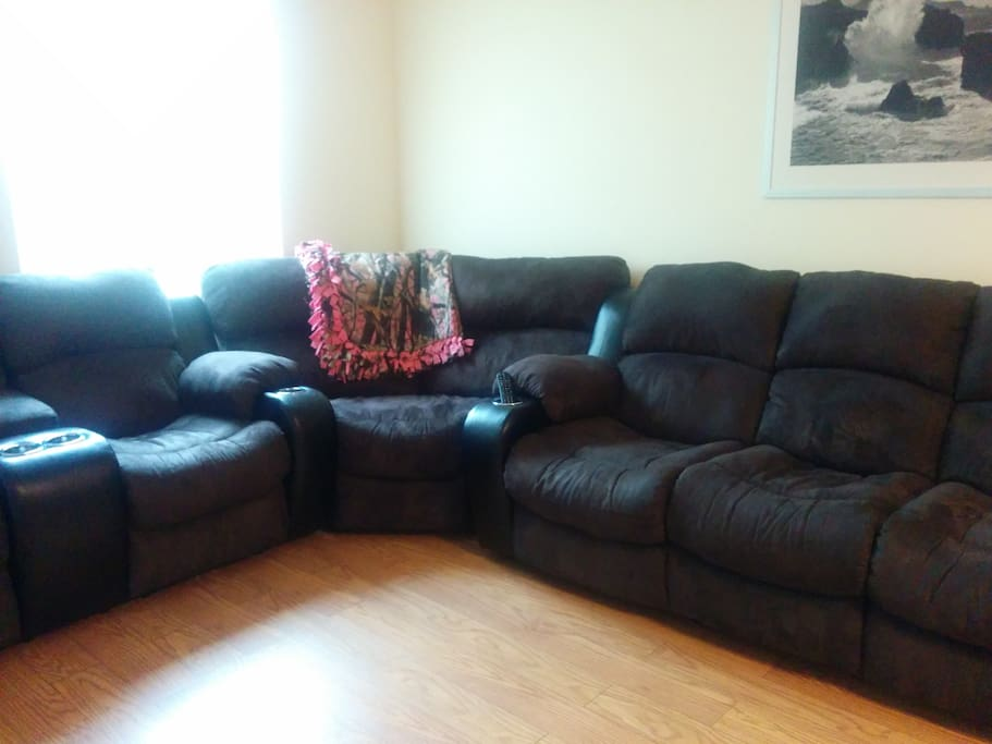 Spacious living room with new 6-person sofa.