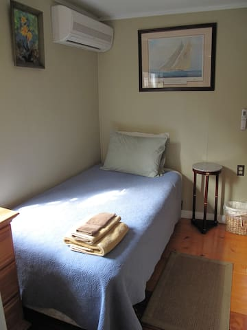 Single Twin Bed for one person, with air conditioning