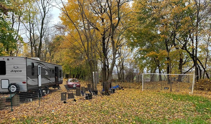 Stay in a modern RV tucked in the suburban woods.