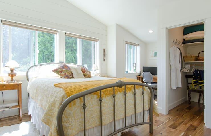 Cozy bedroom with desk area and walk-in closet.