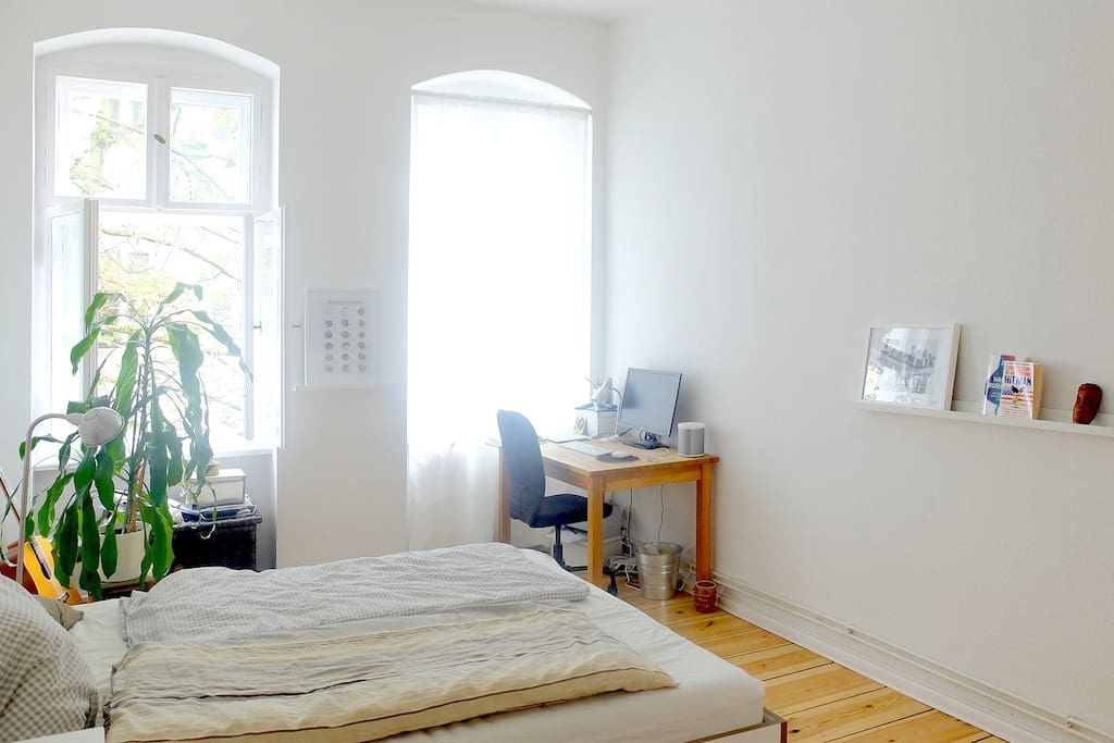 Clean and quiet bedroom with working space.