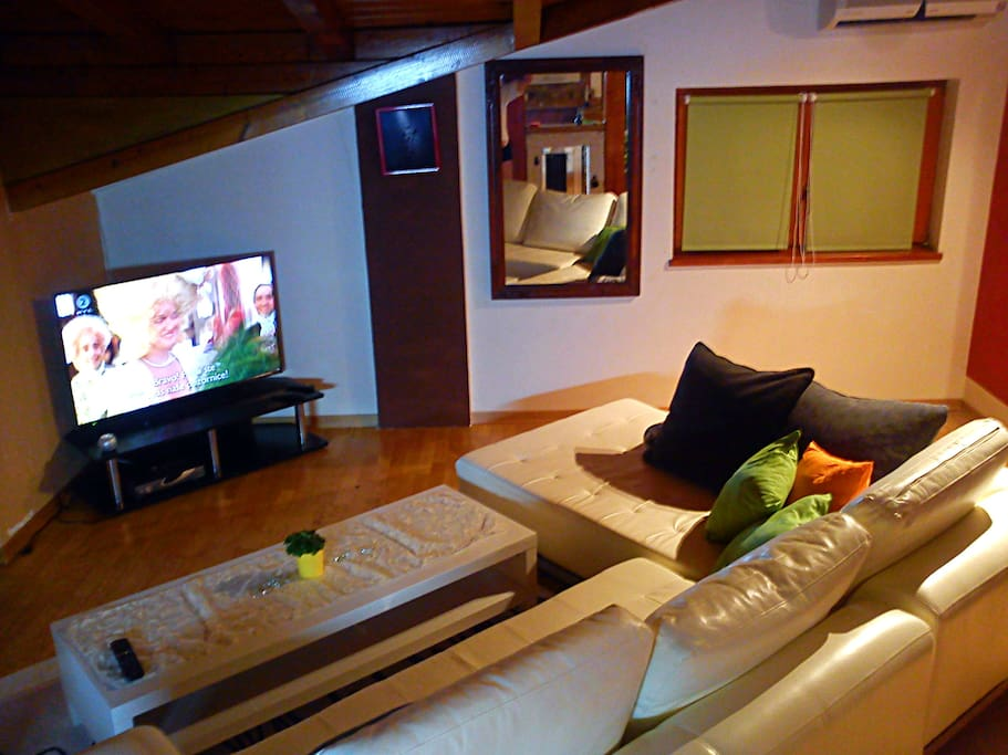 With cozy white furniture you can watch cable on a large LCD television.