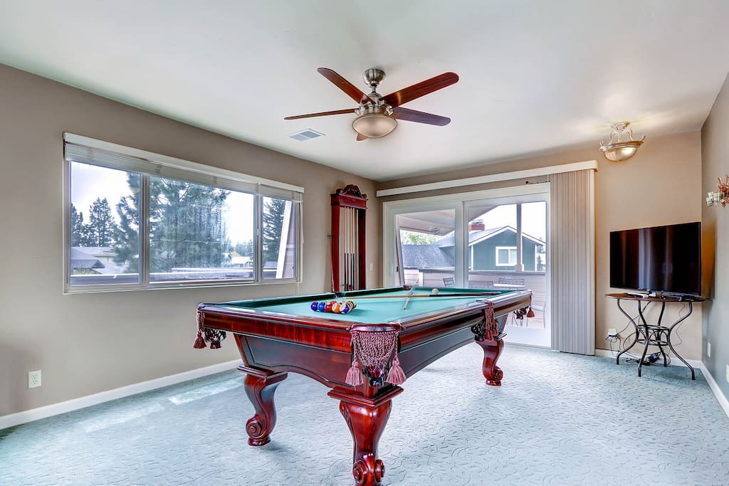 Upstairs game room with regulation pool table and HDTV, step out the door to the rooftop deck