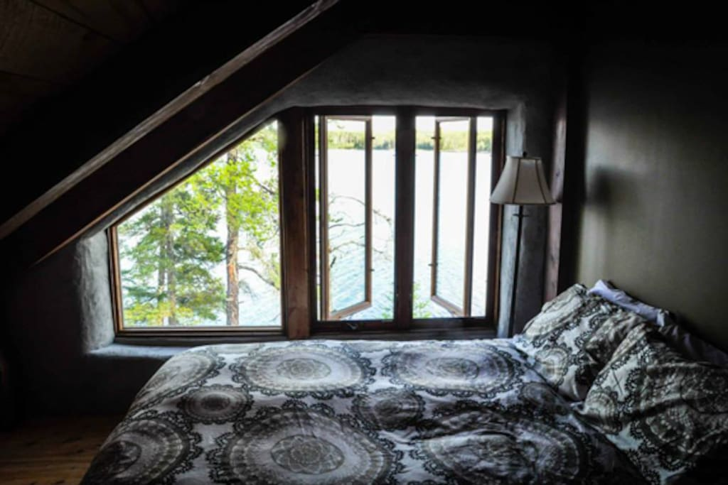 Master bedroom with a view of the lake