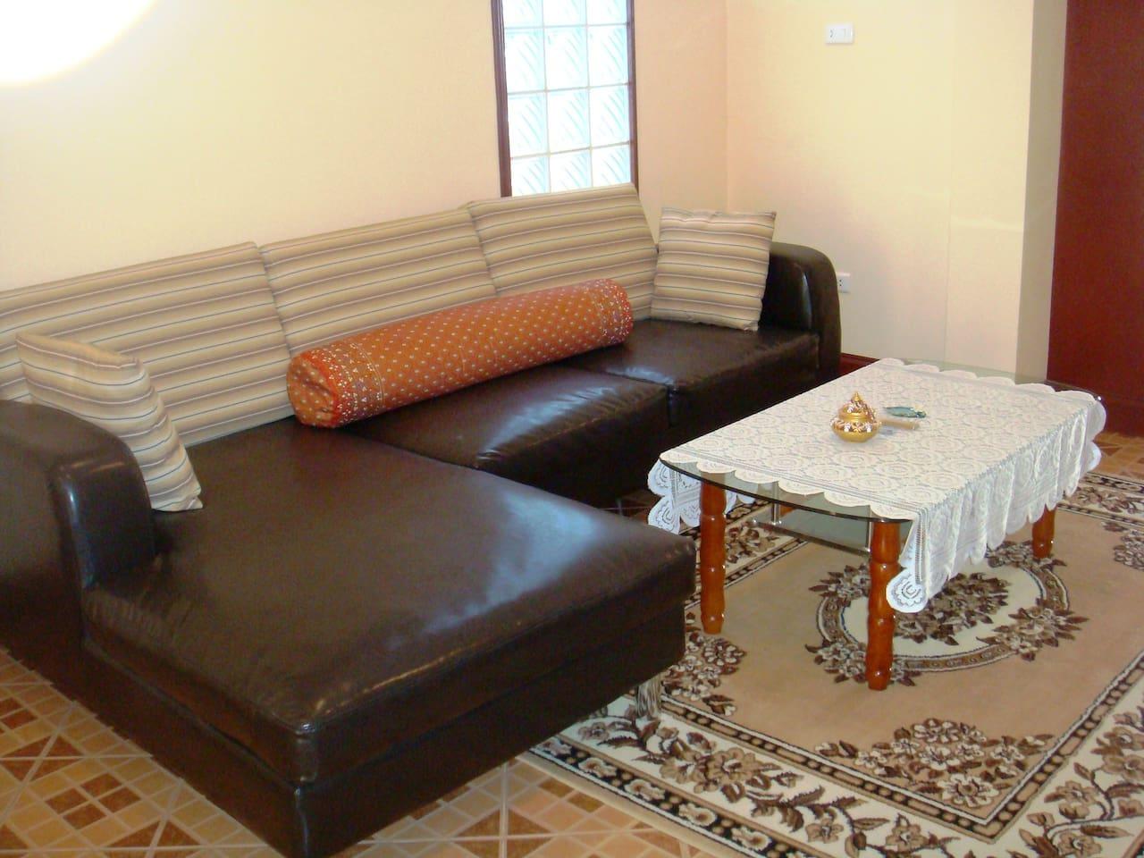 Living room, sofa and coffee table.