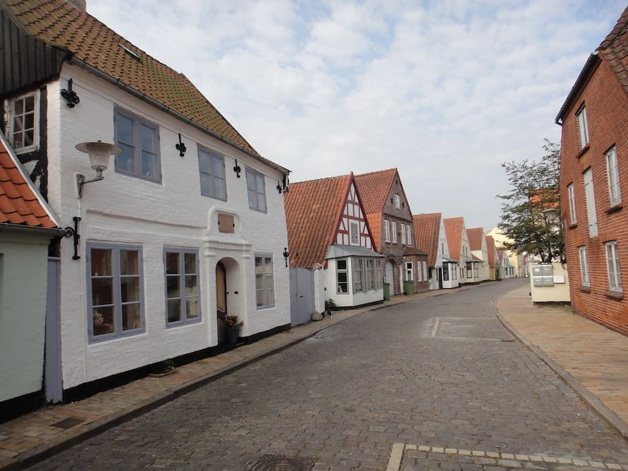 the house is the white one to the left and situated in this old street. The house was build in 1744.