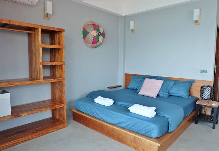 Master bedroom with air con and king size bed
