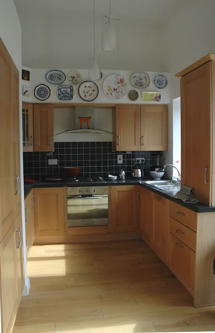 Kitchen area. Gas hob and oven, fridge freezer, dishwasher, gas central heating and dining table that accommodates six.