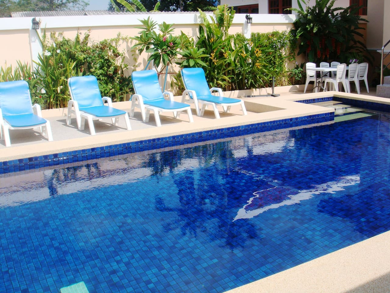 Pool area 8x4 meter saltwater pool with 6 lounge chairs and alfresco dining area for 6.