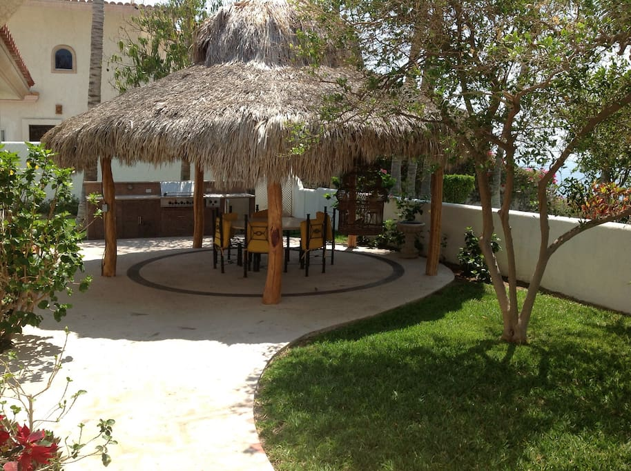 Palapa, seats eight, with outdoor grill.