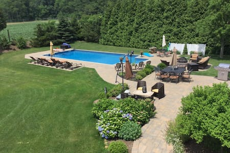 Our home is located in a quiet neighborhood with easy access to the Hamptons. Guests in our home have access to our saltwater pool, private beach access, billiard room, exercise room. The house is within walking distance to a highly regarded New York Times Vineyard and farm stands.