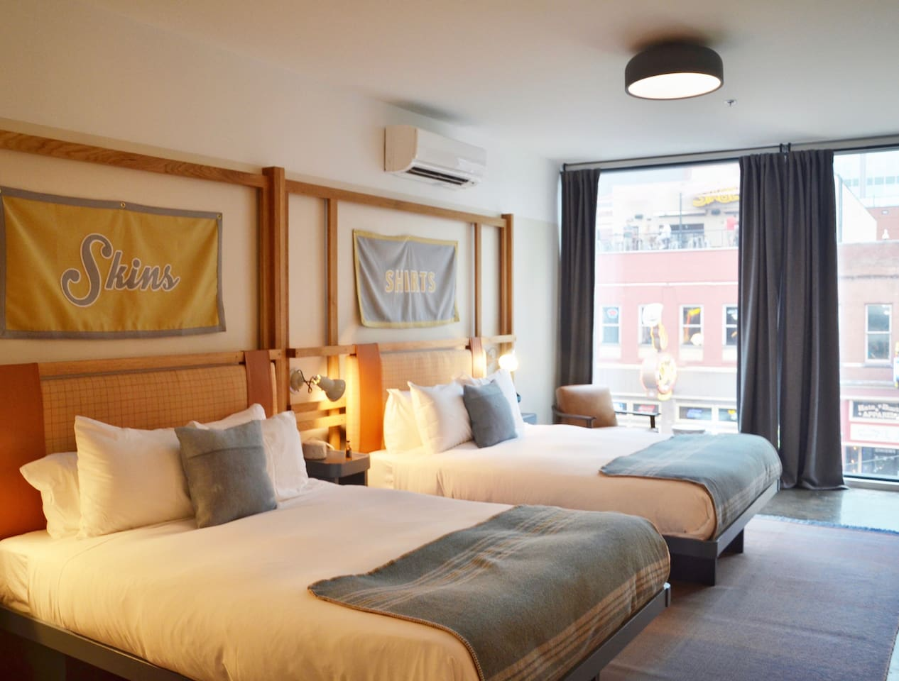 Our Double Queen Room features Casper Mattresses, plush pillows, and floor to ceiling views of Lower Broadway.