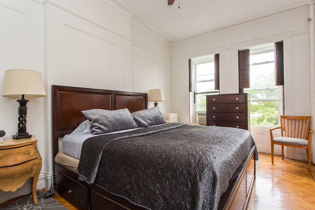 Large & bright master bedroom with original parquet wood floors.
