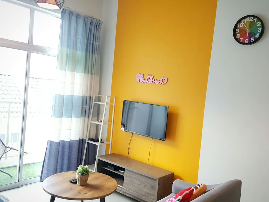 Living room equipped with our Television and colorful wall