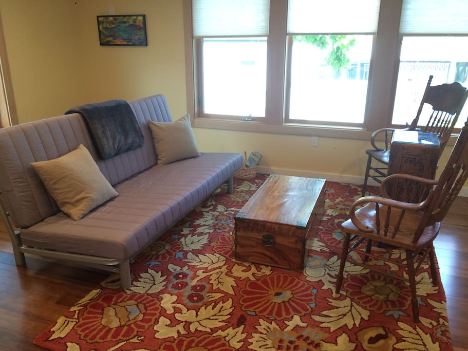 Full size futon in seating area.