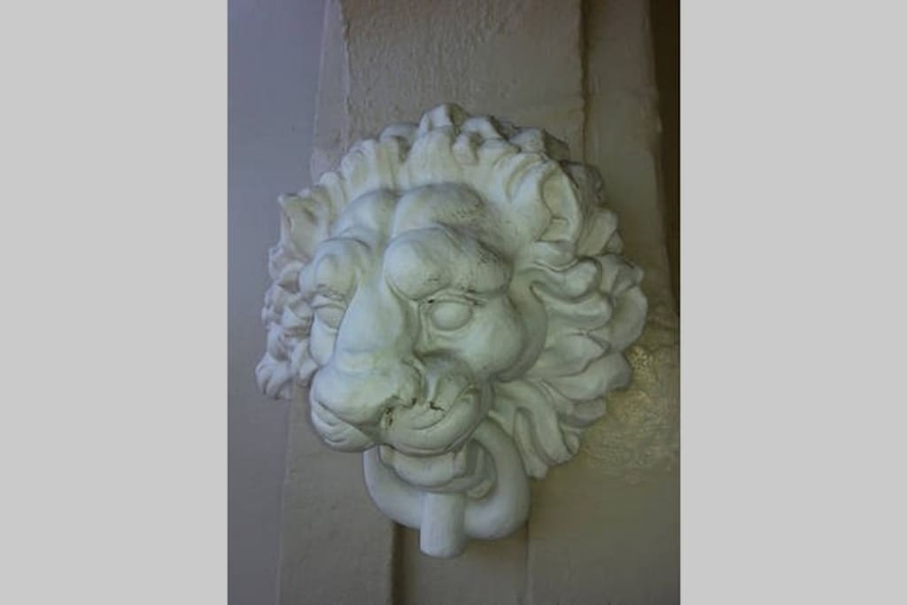 One of many lion heads decorating the exterior walls.