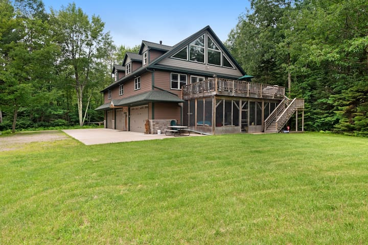 Large, waterfront home w/ a full kitchen, dock, canoes, & outdoor firepit!