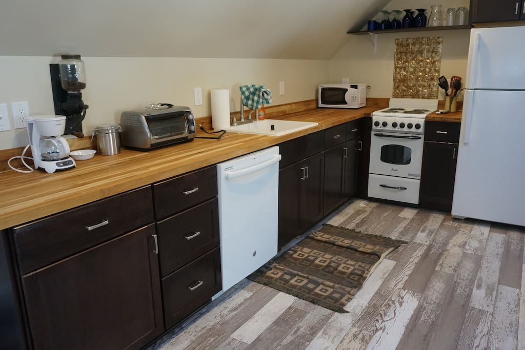 Kitchen offers oven, range, refrigerator, dishwasher, coffee, microwave, and toaster oven