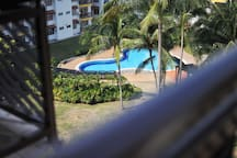 Balcony view into beautiful landscape and swimming pool view