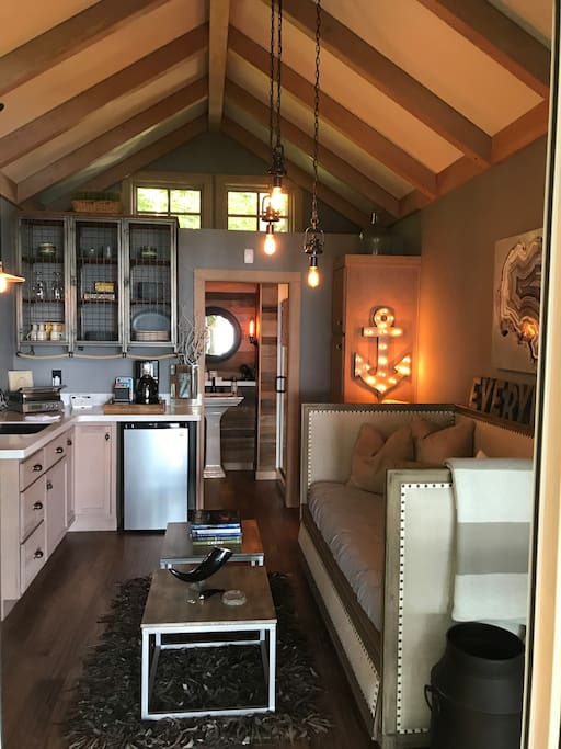 This is the inside view of the cottage including small kitchen, 3/4 bath, and Restoration Hardware day bed that pulls out to two twins next to each other.