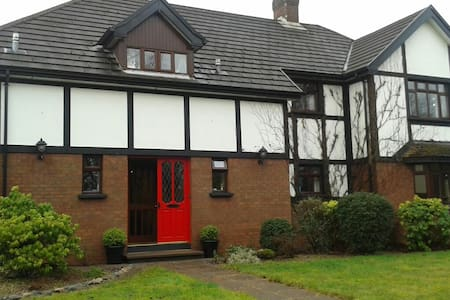 Tudor style house in bluebell wood