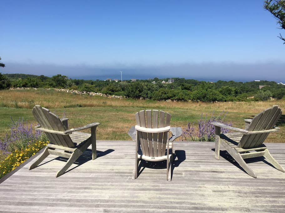 Find serenity on the back deck. 4 rolling acres and expansive ocean views await.