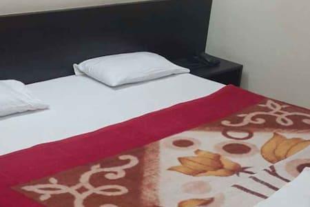 iROOMZ VKG Complex Deluxe A/c Room Bijapur
