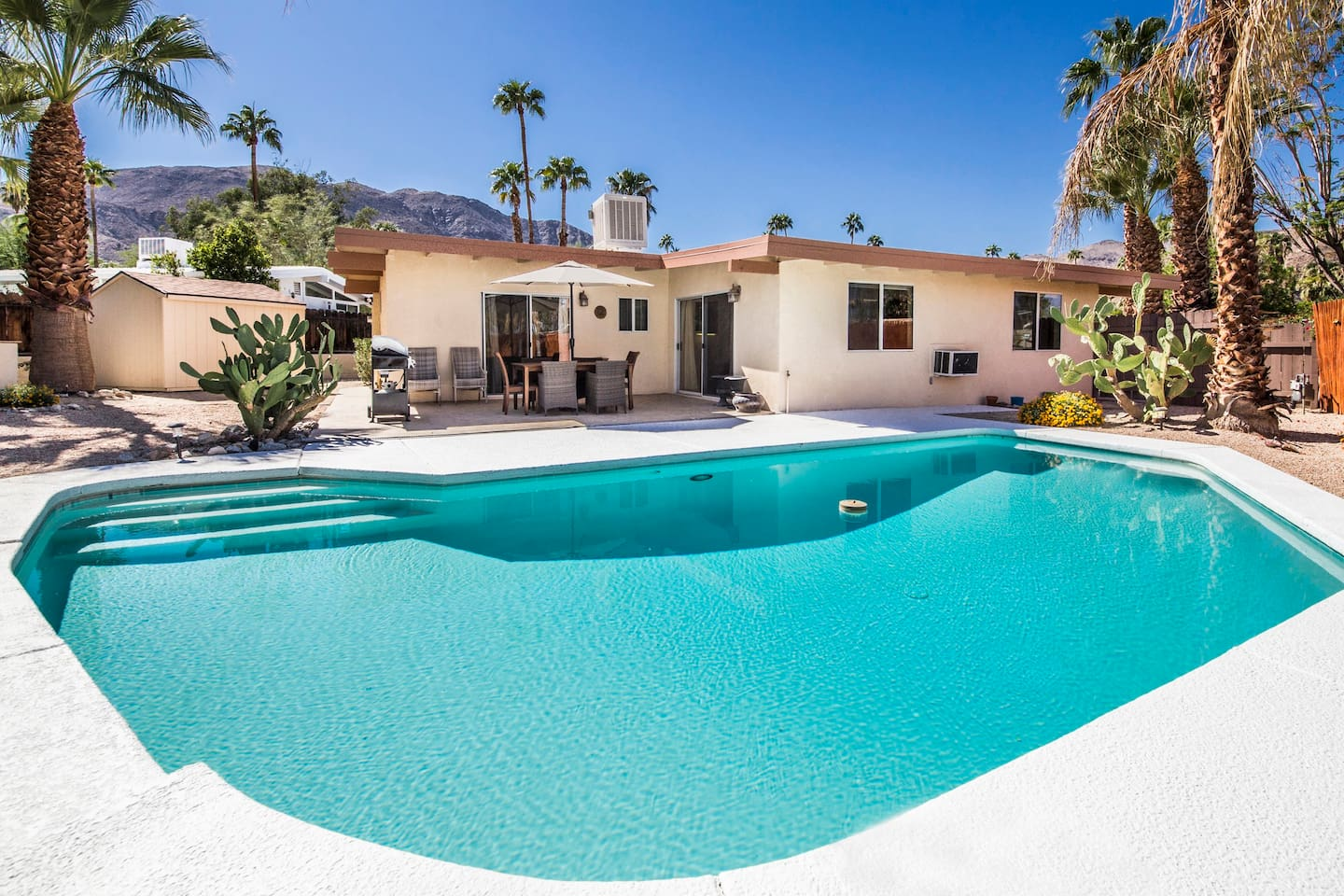 Relax pool side in tranquil setting surrounded by gorgeous panoramic mountain views