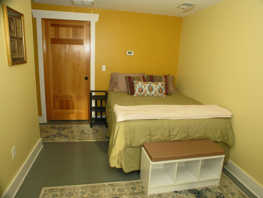 The room features a brand new Queen size mattress.