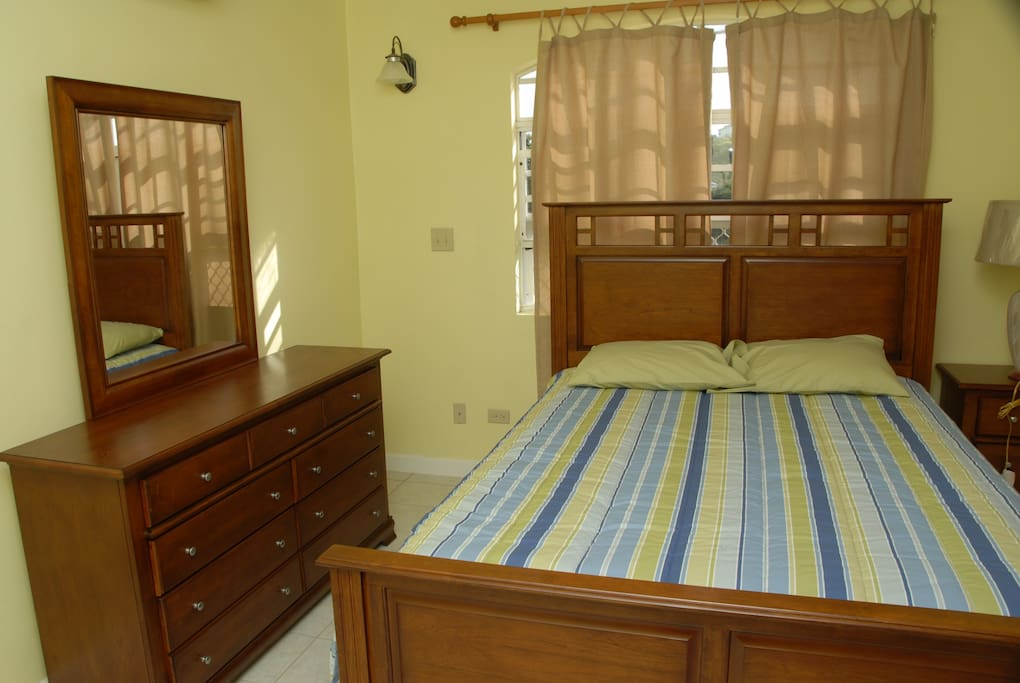 Airy and welcoming queen size bedroom comfortably sleeps 2